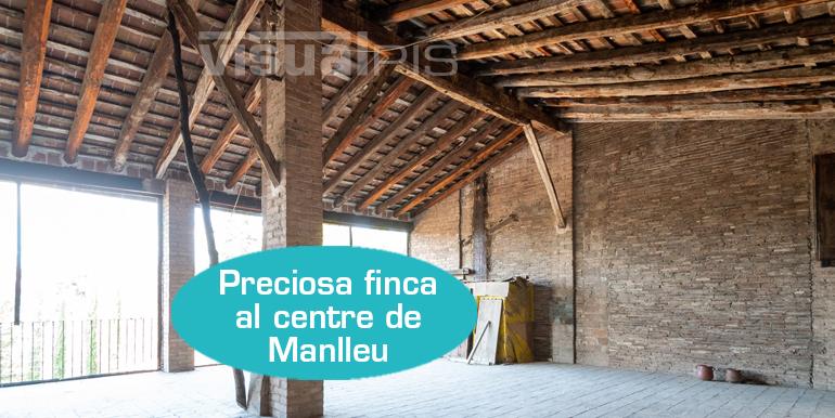 EDIFICI AL CENTRE DE MANLLEU CARRER DEL PONT